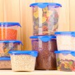 Filled plastic containers on wooden background — Stock Photo #11485602