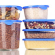 Stock Photo: Filled plastic containers isolated on white