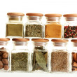 Powder spices in glass jars isolated on white — Stock Photo #11485748