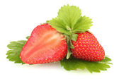 Sweet ripe strawberries with leaves isolated on white — Stock Photo