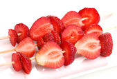 Sweet ripe strawberries on stick isolated on white — Stock Photo