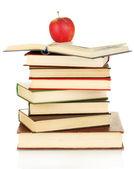 Torre de livros com apple isolado no branco — Fotografia Stock