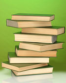 Tower of books on green background — Stock Photo