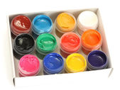 Jars with colorful gouache in paper box on white background close-up — Stock Photo