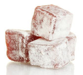 Tasty pieces of turkish delight isolated on white — Stock Photo
