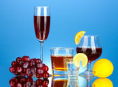 A variety of alcoholic drinks on blue background — Stock Photo