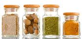 Potes de condimentos em pó em vidro isolado no branco — Foto Stock