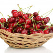Ripe cherry berries in basket isolated on white — Stock Photo