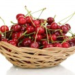 Ripe cherry berries in basket isolated on white - Stock Photo
