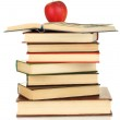 Tower of books with apple isolated on white — Stock Photo