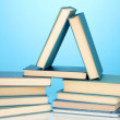 Pile of books on blue background — Stockfoto