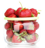Sweet ripe strawberries in jar isolated on white — Stock Photo