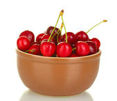 Cherry in brown bowl isolated on white — Stock Photo