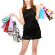 Beautiful young woman with shopping bags isolated on white - Stockfoto