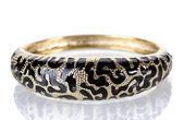 Beautiful golden bracelet isolated on white — Stock Photo