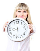 Young business woman holding clock isolated on white — Stock Photo