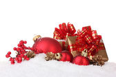 Beautiful red Christmas balls, gifts and cones on snow isolated on white — Stock Photo