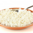 Spoon scoops of cottage cheese in a plate on white background — Stock Photo