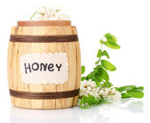 Sweet honey in barrel with acacia flowers isolated on white — Stock Photo