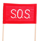 SOS signal written on red cloth isolated on white — Stock Photo