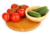 Tomatoes and cucumbers isolated on white — Stock Photo