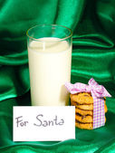 Glass of milk and cookies on green cloth background — Stock Photo