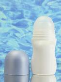 Deodorant on blue sea background — Stock Photo