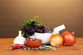 Set of ingredients and spice for cooking on wooden table on brown background — Stock Photo