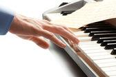 Hand of man playing piano — Stock Photo