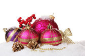 Beautiful pink Christmas balls and cones on snow isolated on white — Stock Photo