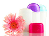 Deodorants with flower isolated on white — Stock Photo
