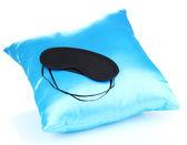 Sleeping mask on pillow isolated on white — Stock Photo