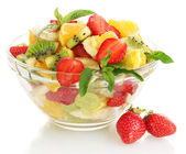 Glass bowl with fresh fruits salad and berries isolated on white — Stock Photo