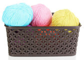 Knitting yarn in plastic basket isolated on white — Stock Photo
