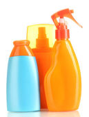 Bottles with suntan cream isolated on white — Stock Photo