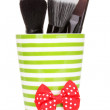 Royalty-Free Stock Photo: Cosmetic brushes in cup isolated on white