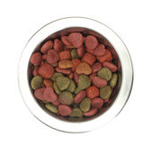Dry dog food in metal bowl isolated on white — Stock Photo