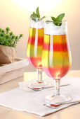 Fruit jelly in glasses on tabla in cafe — Stock Photo
