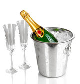 Champagne bottle in bucket with ice and glasses isolated on white — Stock Photo