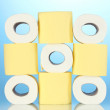 Rolls of toilet paper on blue background — Stock Photo