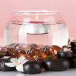 Royalty-Free Stock Photo: Composition of vase with candle and spa stones on red background