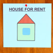 Stock Photo: Poster about renting house on wooden background