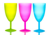 Bright plastic goblets isolated on white — Stock Photo