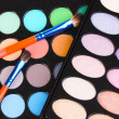 Stock Photo: Bright eye shadows close-up