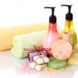 Bottles, soaps, sea salt and towels isolated on white — Stock Photo #11595565
