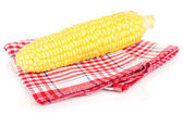 Fresh corn cob on napkin isolated on white — Stock Photo