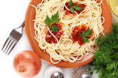 Composition of the delicious spaghetti with tomato sauce and parsley on white background close-up — Stock Photo