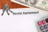 Rental agreement with dollars on wooden background close-up — Stock Photo