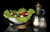 Tasty greek salad isolated on black — Stockfoto
