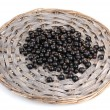 Black currant on wicker mat isolated on white — Stock Photo #11600506